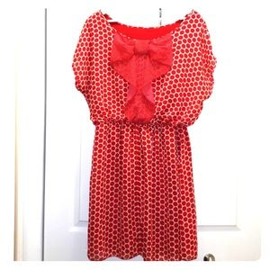red and white poka dot dress with bow in the back
